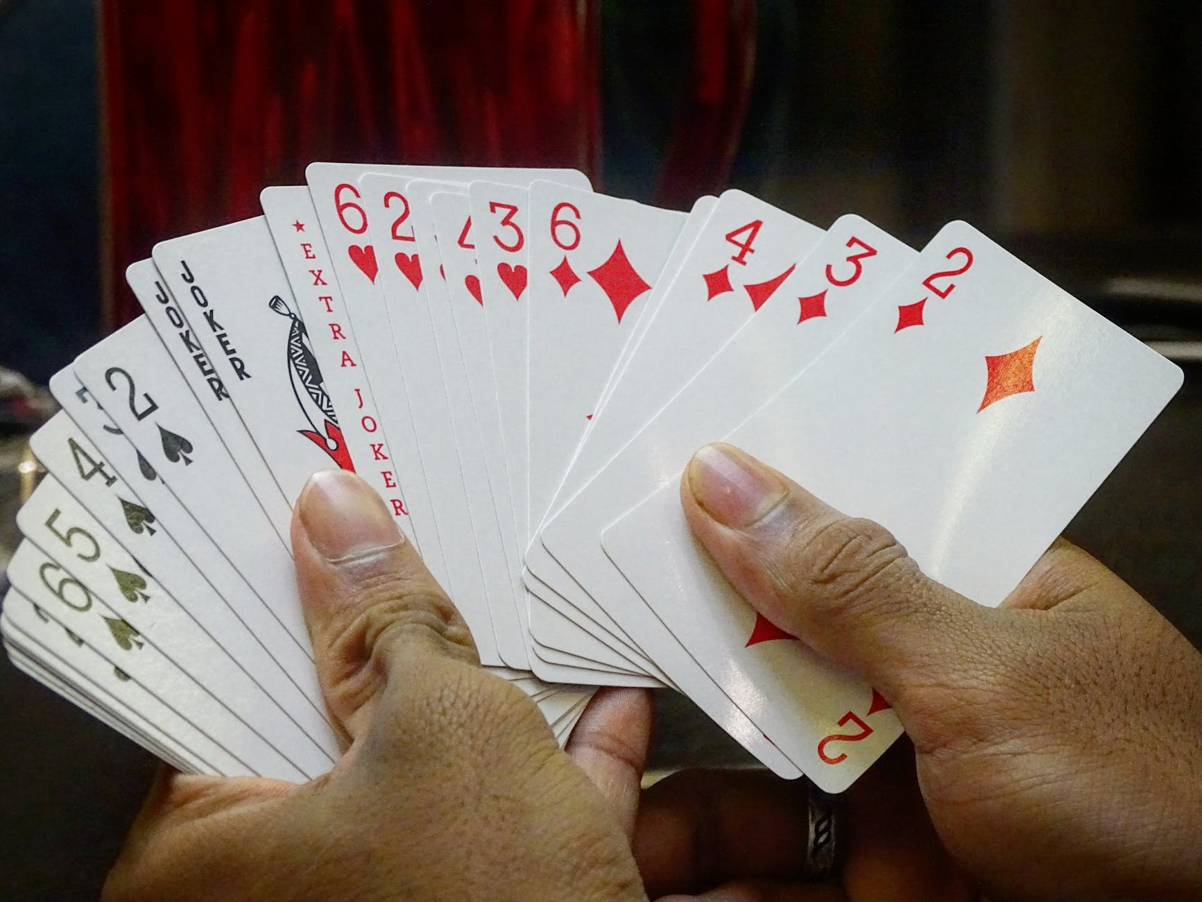 cards held by hands