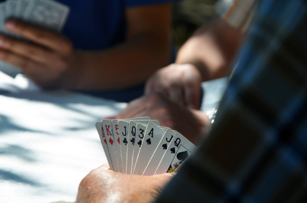 men playing card games