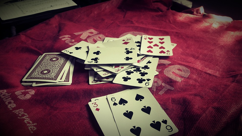 Cuarenta Playing Card Games scattered on a table with cover