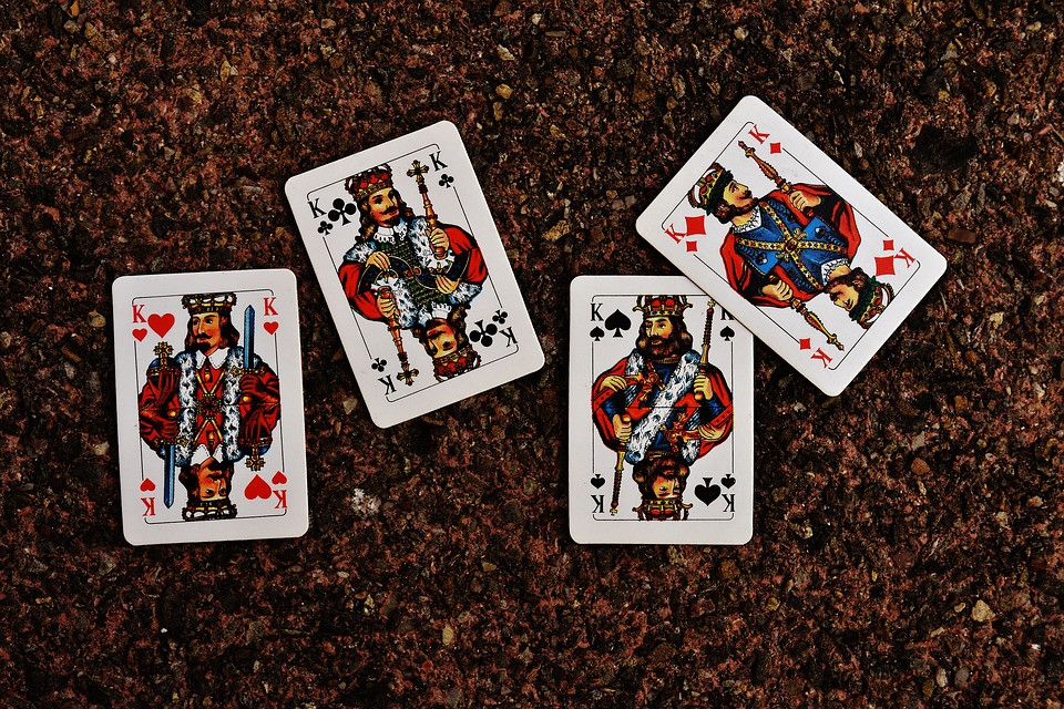Four King Cards on a Cork Board used for Playing Kings Corner Card Game