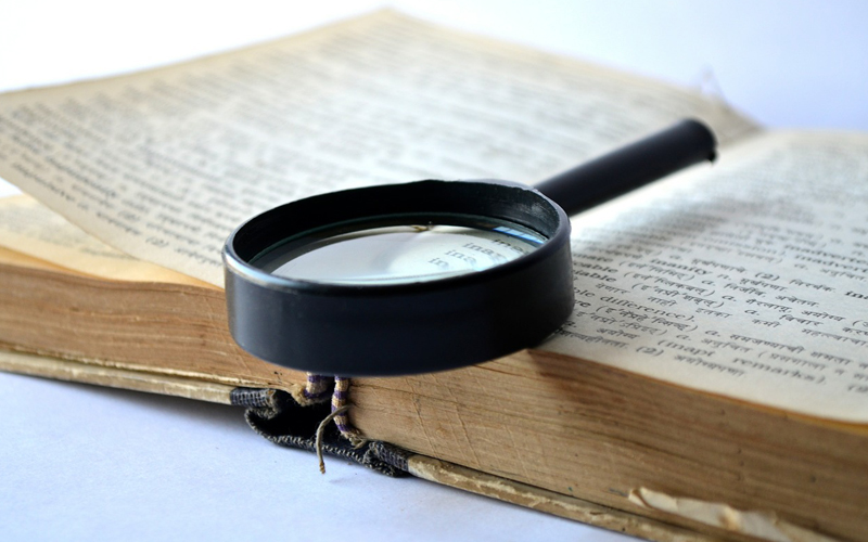 magnifying glass and a dictionary
