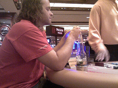 Photo of Long Haired Man Who is Winning at a Pai Gow Poker Game at the Golden Nugget