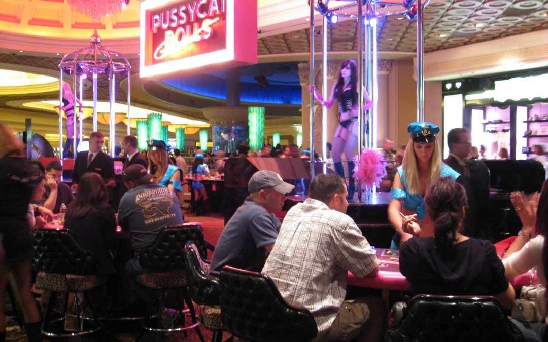 Men and Women Playing Pai Gow Poker at the Pussycat Dolls Casino located at the Caesars Palace in Las Vegas