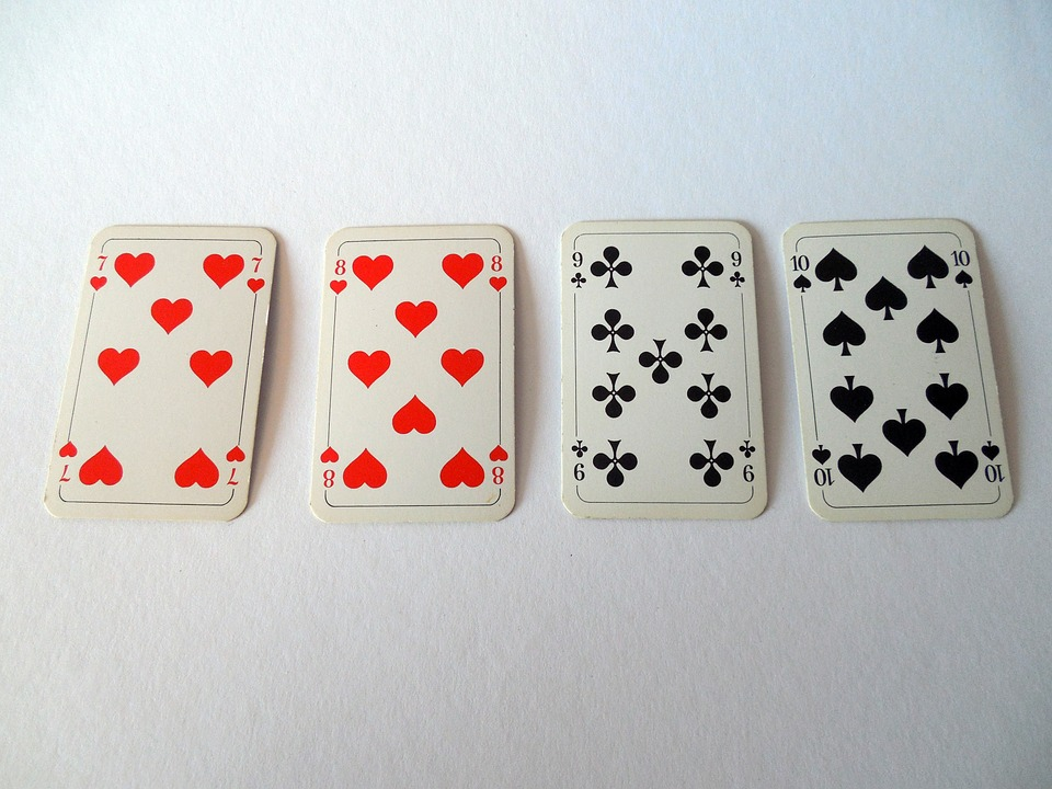 Playing cards on a white surface