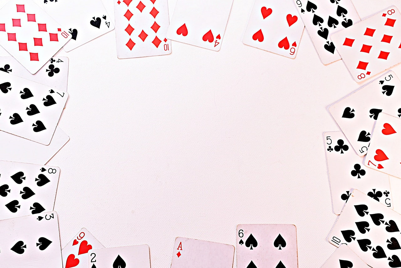 scattered playing cards on white background