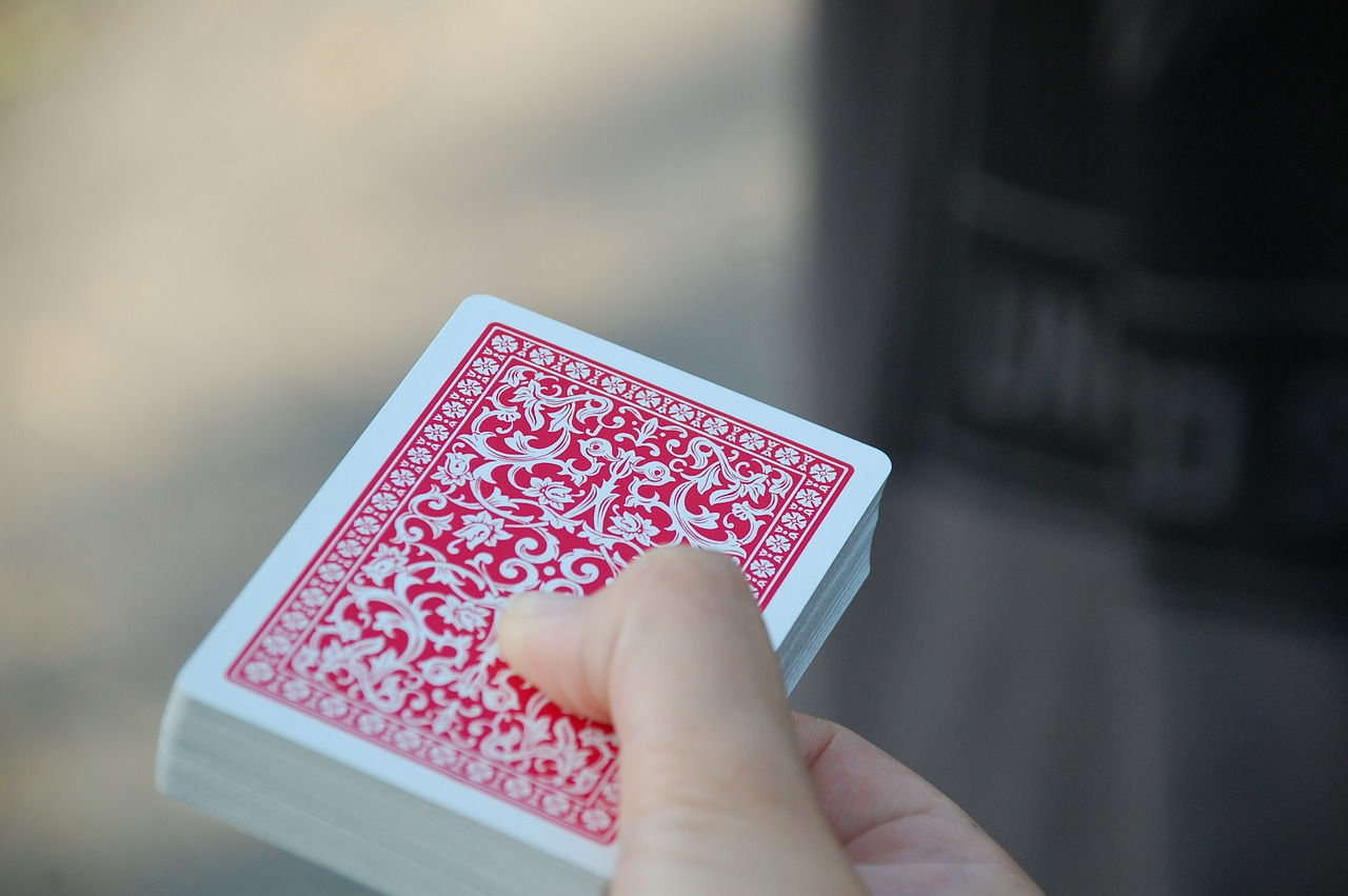 person holding a deck of cards